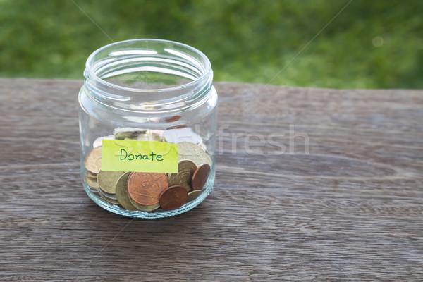 Darować ceny dobroczynność świat monet szkła Zdjęcia stock © vinnstock