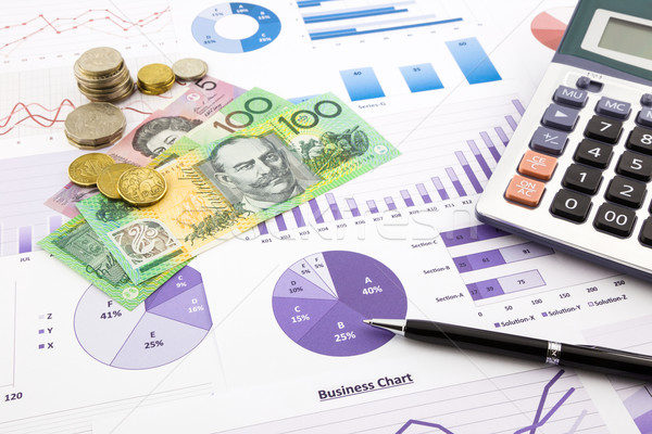 australia currency on graphs, financial planning and expense rep Stock photo © vinnstock