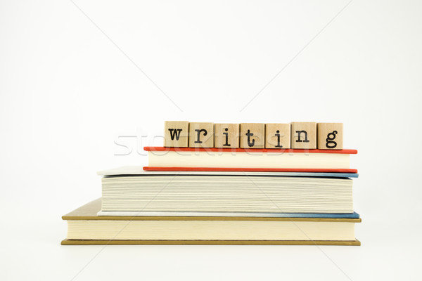 writing word on wood stamps and books Stock photo © vinnstock