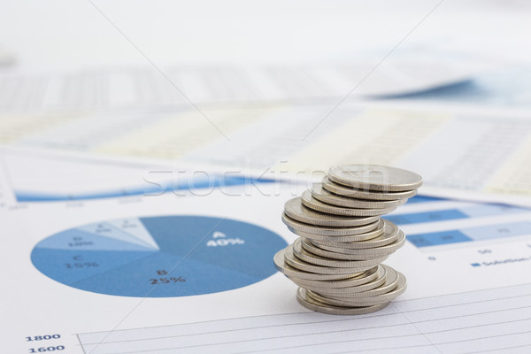 Stack of coins and charts Stock photo © vinnstock