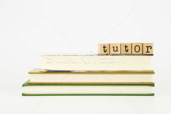 tutor word on wood stamps and books Stock photo © vinnstock