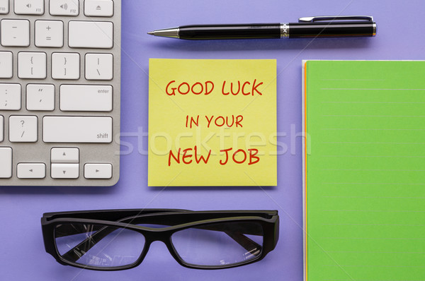 Notepad with words ' Good Luck In Your New Job '  Stock photo © vinnstock