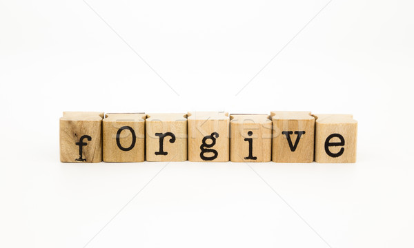 Stock photo: forgive wording, ethic and merit concept