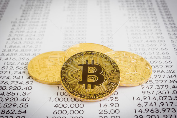 Stock photo: Cryptocurrency, Gold bitcoins on transaction report.