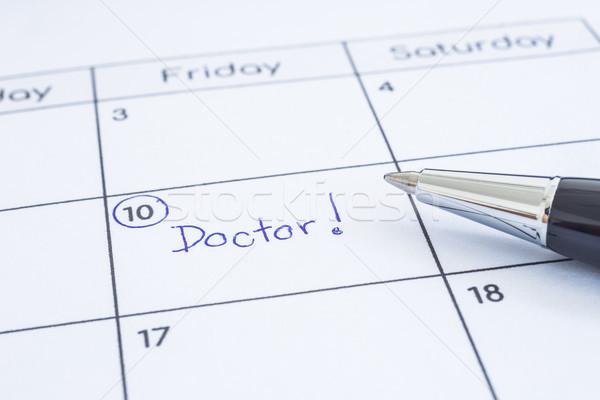 Doctor appointment date writing on calendar.  Stock photo © vinnstock