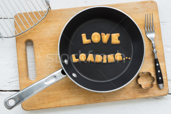 Letter biscuits word LOVE LOADING and cooking equipments. Stock photo © vinnstock