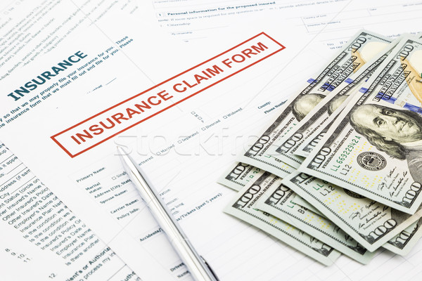 insurance claim form and money Stock photo © vinnstock
