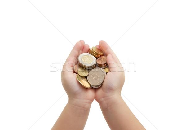isolated of child's hands holding coins  Stock photo © vinnstock