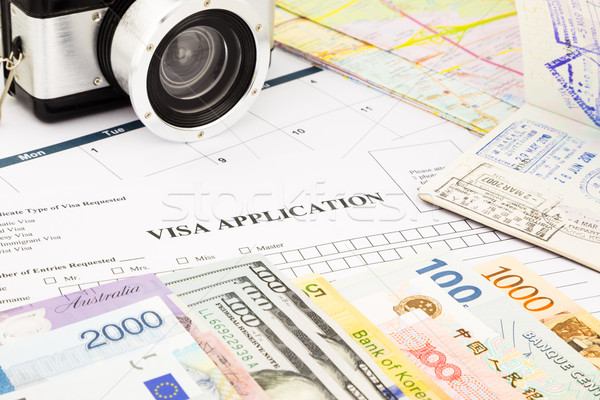 visa application form, passport, world currency and banknotes  Stock photo © vinnstock