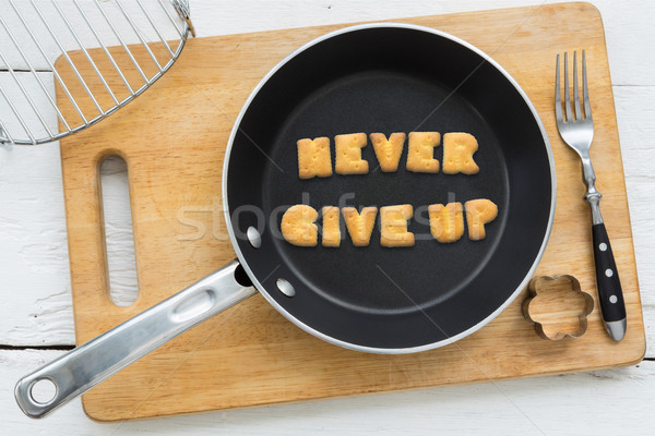 Letter cookies quote NEVER GIVE UP and kitchen utensils Stock photo © vinnstock