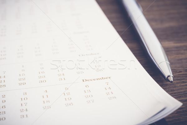 Calendar agenda review for business schedule planning. Stock photo © vinnstock