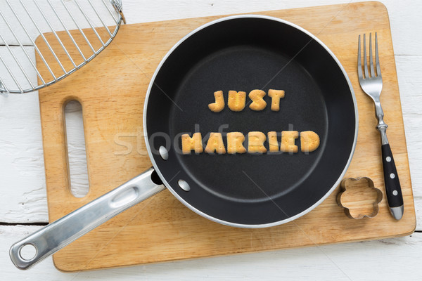 Letter cookies word JUST MARRIED and kitchen utensils Stock photo © vinnstock