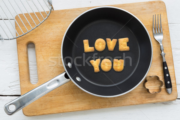 Letter cookies word LOVE YOU and kitchen utensils Stock photo © vinnstock