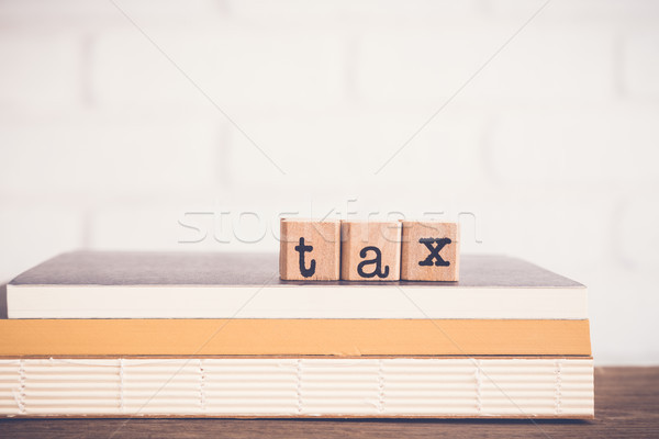 Mot impôt alphabet bois caoutchouc Photo stock © vinnstock