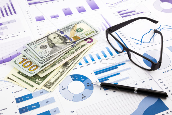 dollar currency on graphs, financial planning and expense report Stock photo © vinnstock