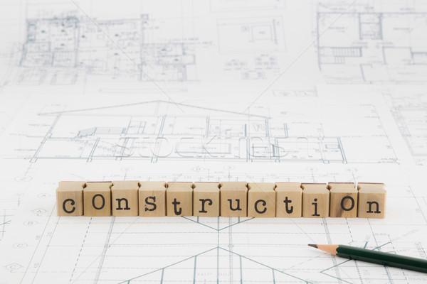 construction word blocks stack on blueprints and floor plan Stock photo © vinnstock