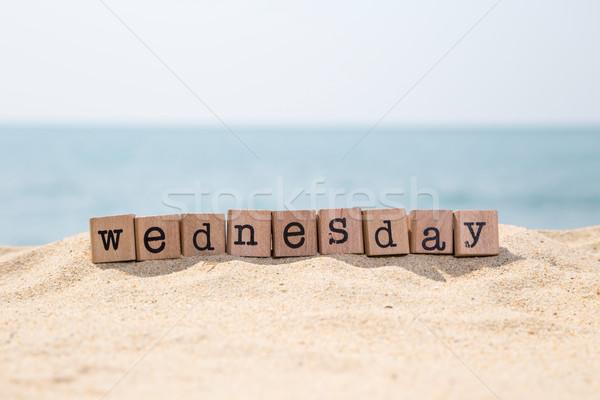 wednesday word on seaside Stock photo © vinnstock