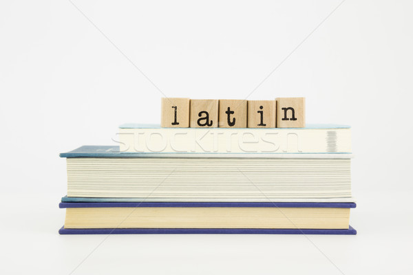 latin language word on wood stamps and books Stock photo © vinnstock