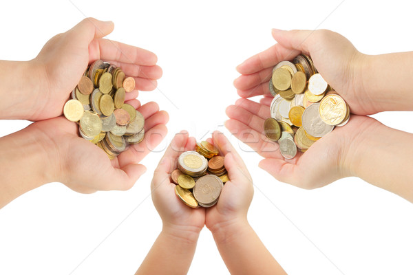 isolated of human's hands holding coins  Stock photo © vinnstock