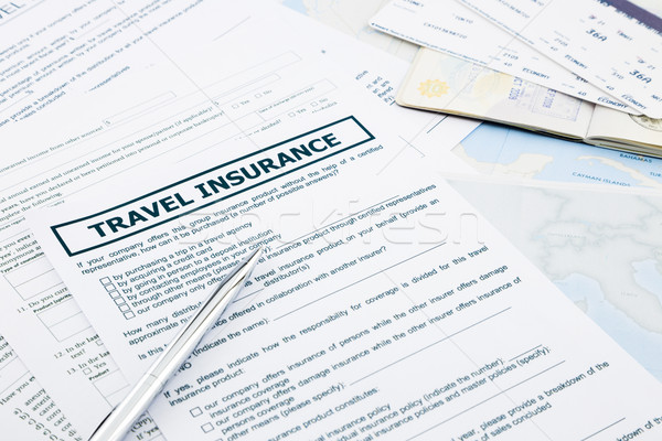 travel insurance form, passport and tickets  Stock photo © vinnstock