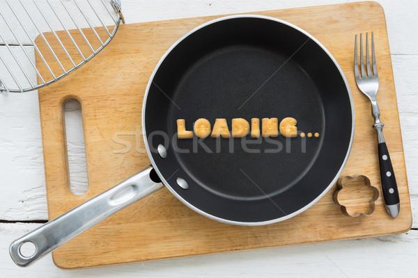 Letter cookies word LOADING and kitchen utensils Stock photo © vinnstock