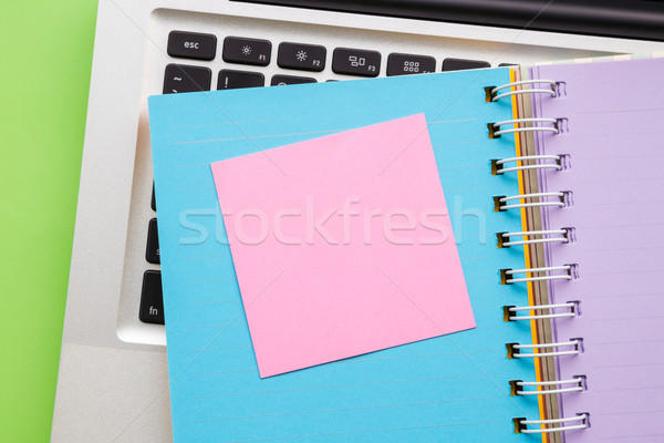 Blank pink paper on colorful note book  Stock photo © vinnstock