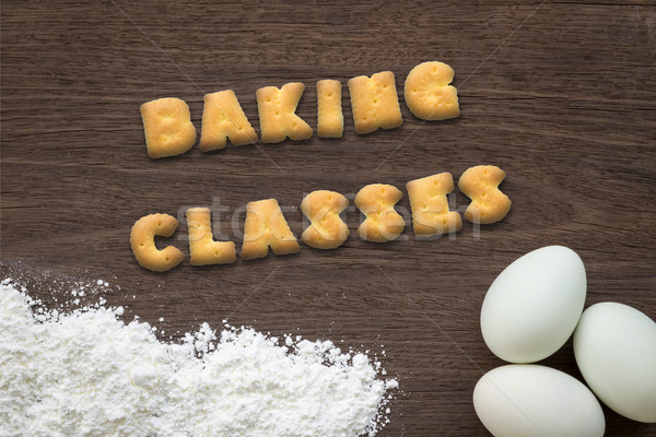 Letter biscuits word BAKING CLASSES  on kitchen table background Stock photo © vinnstock