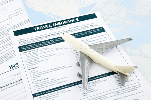 travel insurance form and   plane model Stock photo © vinnstock