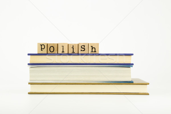 polish language word on wood stamps and books Stock photo © vinnstock