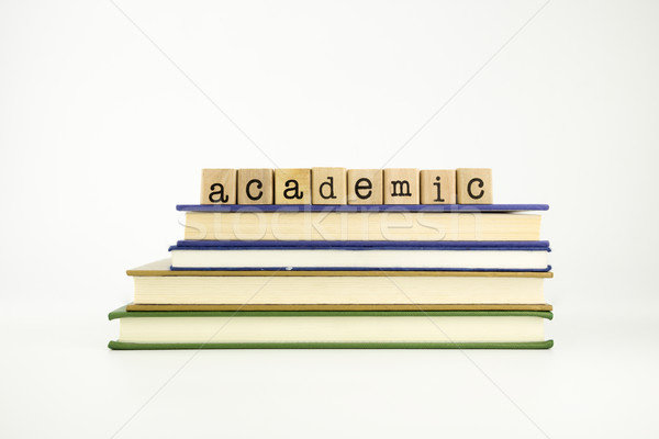 academic word on wood stamps and books Stock photo © vinnstock