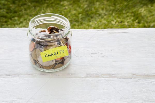 Jótékonyság pénz disztribúció világ érmék üveg Stock fotó © vinnstock
