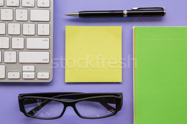 Blank yellow notepad on office table Stock photo © vinnstock