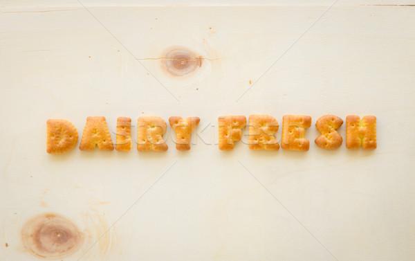 Palabra lácteo frescos alfabeto galletas madera Foto stock © vinnstock