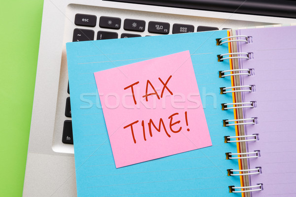 Notepad with word ' TAX TIME ' on paper book  Stock photo © vinnstock