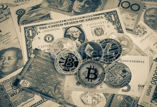 Cryptocurrency, bitcoins on world currency money, vintage. Stock photo © vinnstock