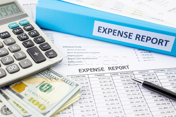 Stock photo: Financial expense report with money