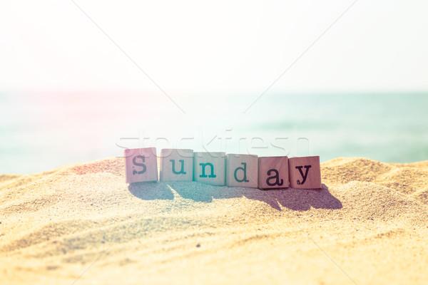 Sunday word on sea beach in retro style  Stock photo © vinnstock