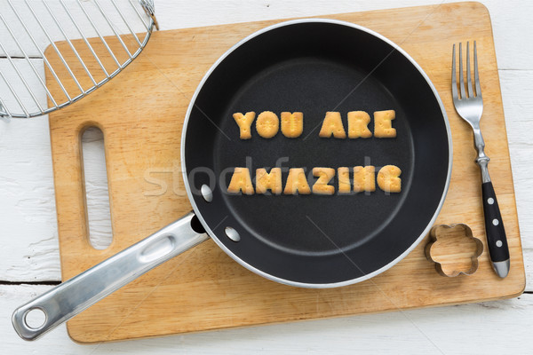 Cookie biscuits quote YOU ARE AMAZING in frying pan Stock photo © vinnstock