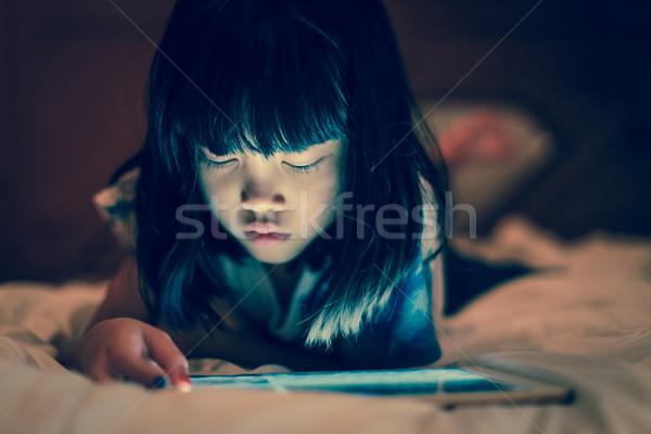 Kid using tablet for online learning at home. Stock photo © vinnstock