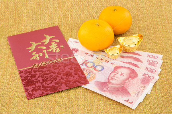 chinese new year with money yuan banknote and ingot Stock photo © vinnstock