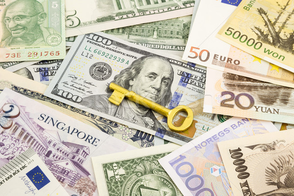 golden key  and world currency money banknotes  Stock photo © vinnstock