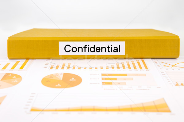 Confidential documents, graph analysis and undisclosed reports Stock photo © vinnstock