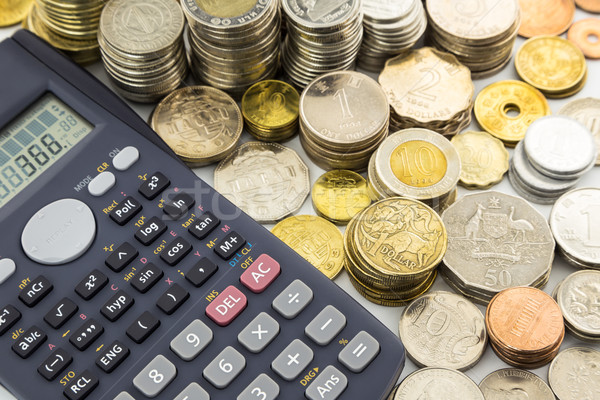 world currency coins and calculator Stock photo © vinnstock