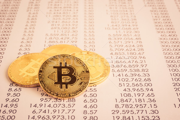 Cryptocurrency, Gold bitcoins on transfer statement. Stock photo © vinnstock