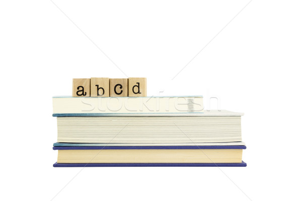 abcd word on wood stamps and books Stock photo © vinnstock