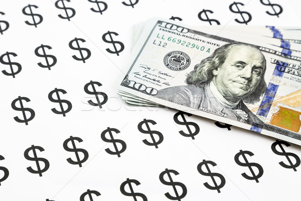 dollar sign and money currency banknotes Stock photo © vinnstock