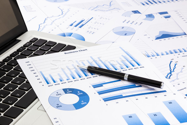laptop and pen with blue business charts, graphs, statistic and  Stock photo © vinnstock