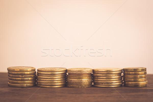 Saving money gold coins stacks, copy space.  Stock photo © vinnstock