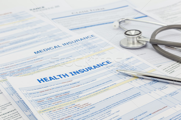 Medical insurance application and legal contract Stock photo © vinnstock