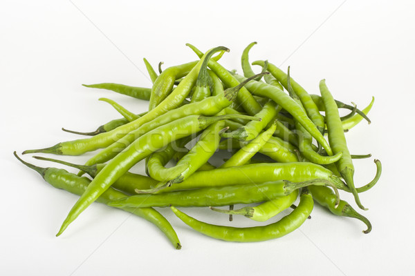 Green chillies on white Stock photo © vinodpillai